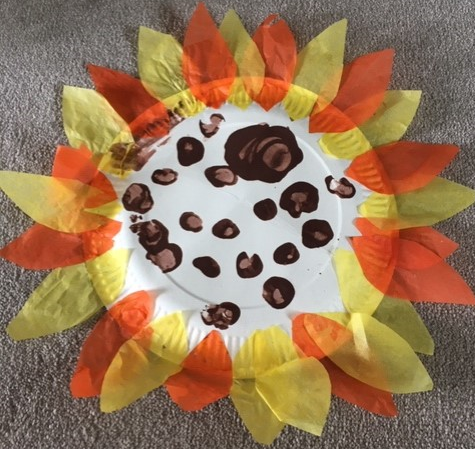 Sunflower creation with tissue paper and fingerpainting - by Rhys